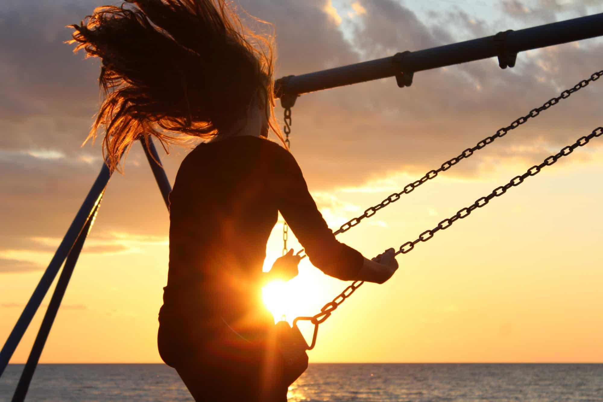 Joyful Balance Wellness - woman on a swing